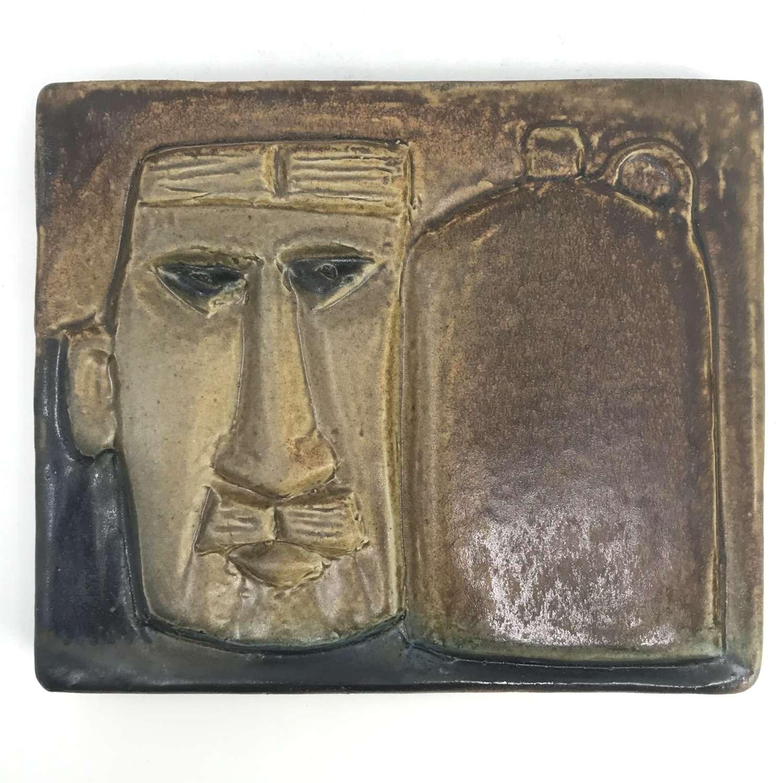 Ake Holm man with a flagon stoneware wall plaque Hoganas Sweden